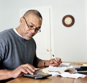 Mature man doing finances in home office